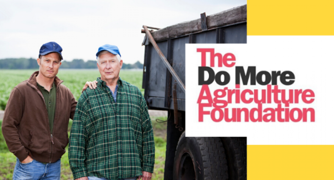 Image of two farmers standing near trucks with The Do More Agriculture Foundation logo